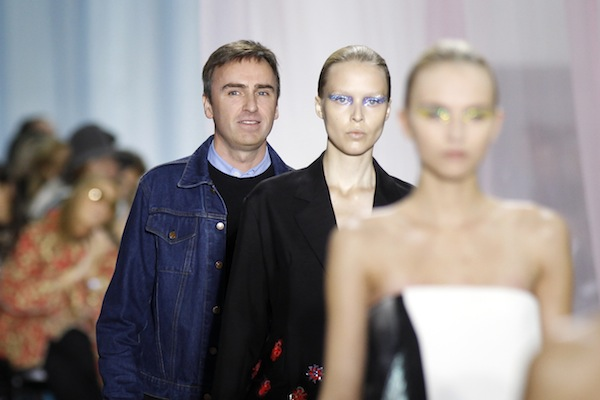 Belgian designer Raf Simons appears at the end of his Spring/Summer 2013 women's ready-to-wear fashion show for French house Dior during Paris fashion week